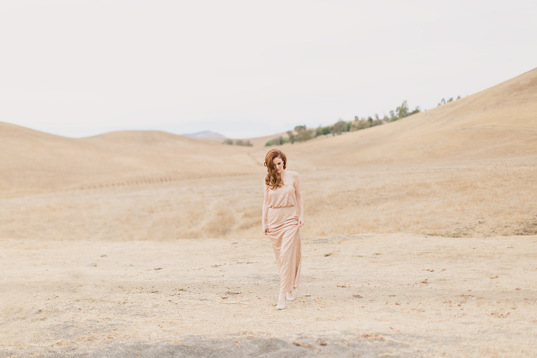 redhead model posing in livermore hills wearing gold dress