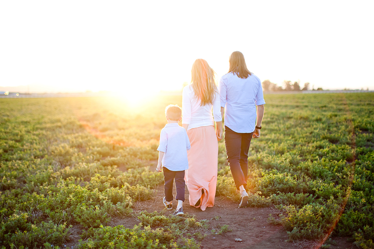 beautiful family portrait walking into the sunset in mountain house california