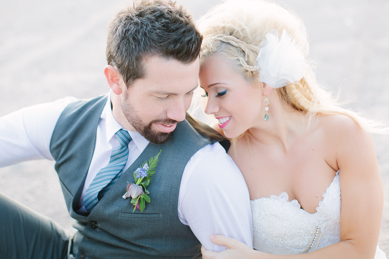 bride and groom snuggling for portrait by Sarah Tyler Photography in Las Vegas