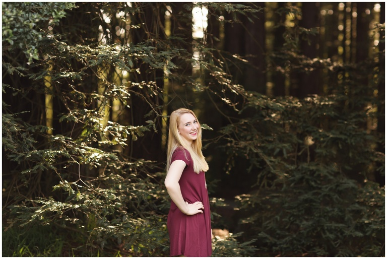 high school senior in red dress in redwoods