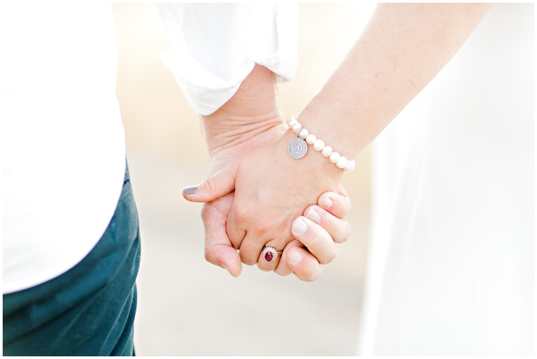 detail portrait of just couples hands intertwined