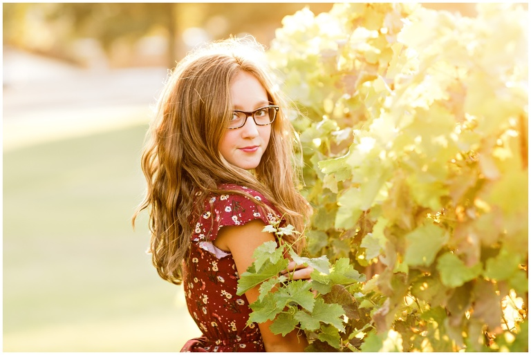 headshot of teen next to Livermore vineyards